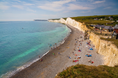 bathers: Bathers at Birling Gap at Seven Sisters cliffs in East Sussex, UK.