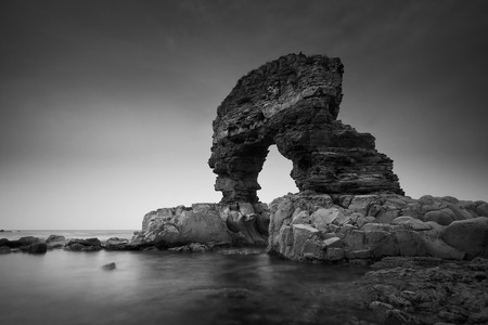 rock arch: Rock arch on the coast of Tyne and Wear, UK. Stock Photo