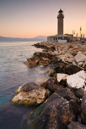greece shoreline: Lighthouse in Patras Greece. Stock Photo