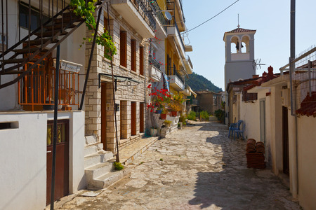bell tower: Church bell tower in a street of Nafpaktos village Greece. Stock Photo