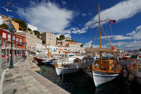 seafronts: Seafront with shops and boats in the harbour of Hydra Editorial