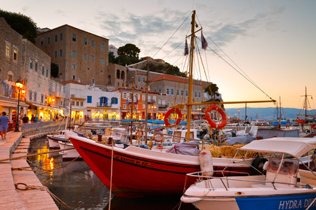 Port of Hydra with shops and fishing boats Редакционное