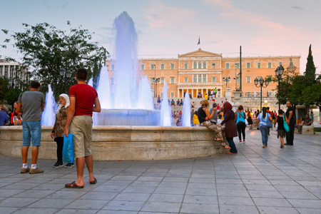 syntagma: People around a fountain in Syntagma square in front of the Greek parliament