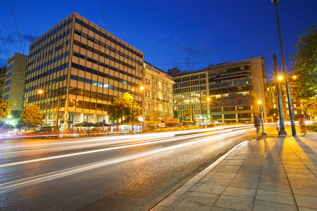 syntagma: Buildings and night traffic in Syntagma square in Athens Editorial