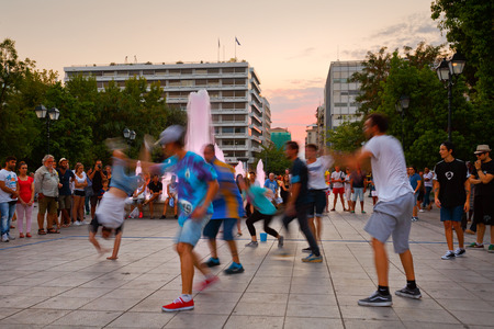 syntagma: Group of street artists performing in Syntagma square attracting a crowd of spectators
