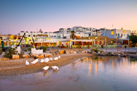 cycladic: Newer part of the village of Naousa with restaurants on the seafront and hotels behind them, Greece