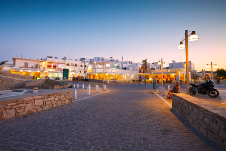 cycladic: Newer part of the village of Naousa with restaurants and hotels behind them, Greece Editorial