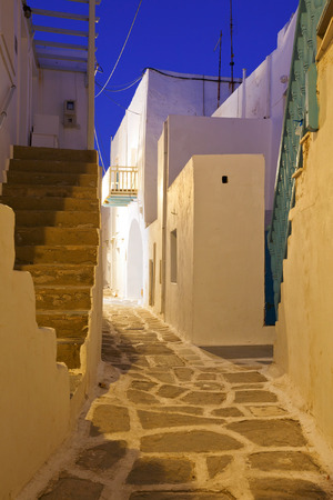 cycladic: Street with traditional architecture in the old part of Naousa village on Paros island, Greece. Stock Photo