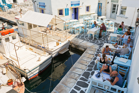 cycladic: Naousa, Paros, Greece, town, Cyclades, island, Europe, Mediterranean, Cycladic, Greek, cityscape, buildings, architecture, traditional, old, old town, street, shops, flowers, tables