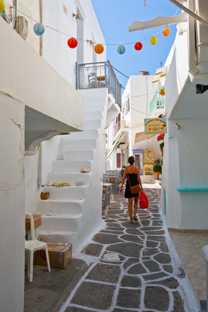 cycladic: Street with traditional architecture and some small shops in the old part of Naousa village on Paros island, Greece Editorial