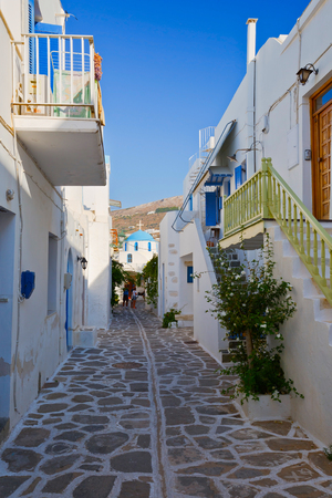 cycladic: Street with a church in the old part of Parikia, the capital and main port of Paros island in Greece Editorial