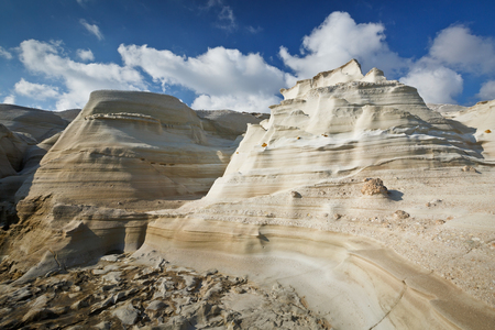 cycladic: Rock formation of eroded volcanic rock on the coast nearby Sarakiniko beach in the north of Milos island. Stock Photo