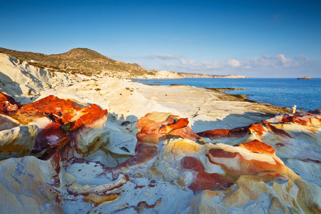 cycladic: Coast nearby Mandrakia village in the north of Milos island lit by morning light.