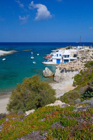 greece shoreline: Traditional boat houses and fishing boats in Mytakas, Milos island, Greece