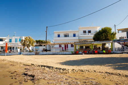 seafronts: Beach and coffee shops in Pollonia village in Milos island, Greece