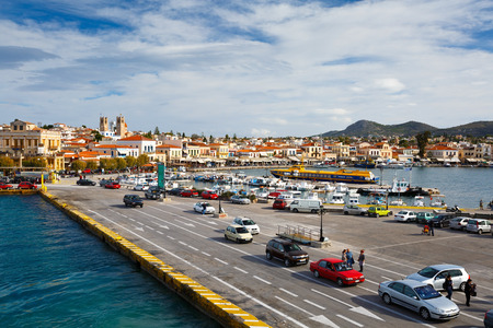 moder: View of Aegina town and its harbour vith the moder quay for large ships where people are waiting for boarding a ferry, Greece Editorial