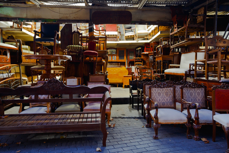 arm chairs: Antique furniture shop in the flea market in the Monastiraki area in Plaka, Athens Editorial