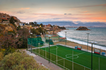 terrain foot: View of the sports grounds and a beach in Piraeus, Greece Banque d'images