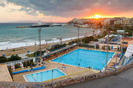 zea: View of the municipal swimming pool in Piraeus and mouth of Zea marina, Greece. Editorial