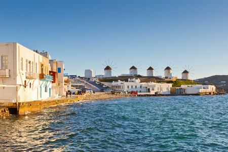 molino: Windmills in the town of Mykonos as seen from Little Venice, Greece.