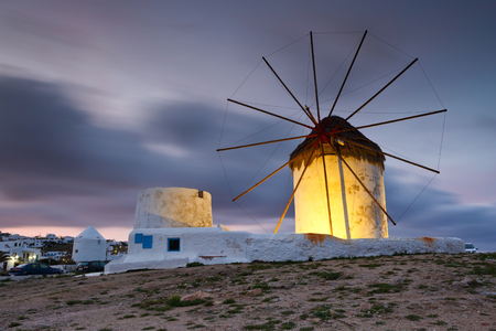 cycladic: Old traditional windmills over the town of Mykonos.