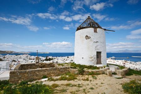 traditional windmill: Old traditional windmill and town of Mykonos in Cyclades, Greece.