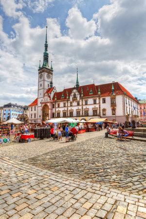 olomouc: Olomouc, Czech Republic - June 04, 2016: Market in the main square of the old town of Olomouc, Czech Republic. HDR image.
