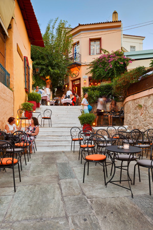 old people: People having drinks in the old town of Plaka. Editorial