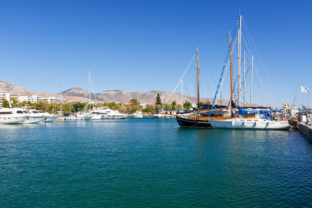 Sail boats in Alimos marina and Himettus mountains in the bacground.