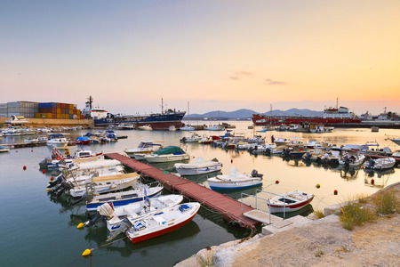 motor boats: Small harbour with fishing boats and motor boats between terminal 3 of the container port and shipyards of Perama. Editorial