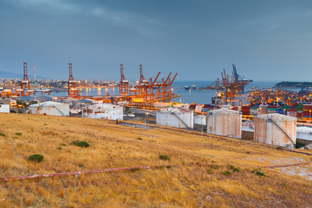 pct: Container port of Piraeus at sunset.