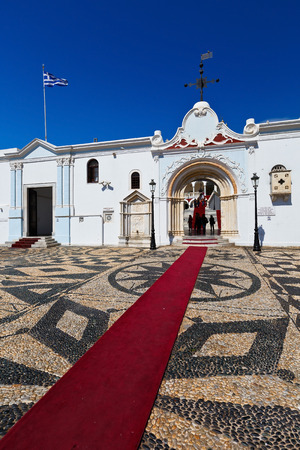 cycladic: Entrance to the complex of Panagia Evangelistria church in Tinos town. Editorial