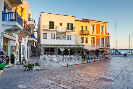 Restaurants, coffee shops and shops in the centre of the old town of Tinos. Editorial