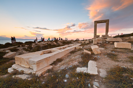 remains: View of Portara and remains of temple of Apollo at sunset.