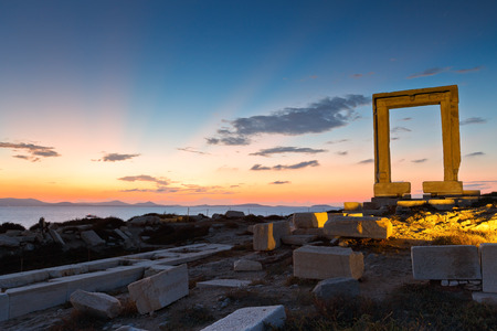 View of Portara and remains of temple of Apollo at sunset.