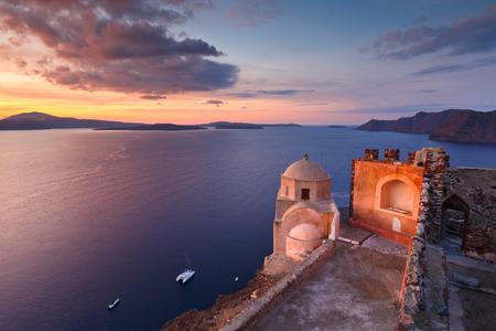 View of Venetian castle in Oia village on Santorini island. Stock Photo