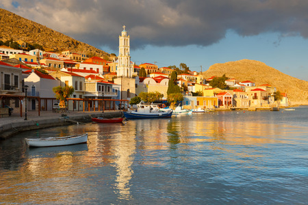 seafronts: View of Halki village and its harbor, Greece. Stock Photo