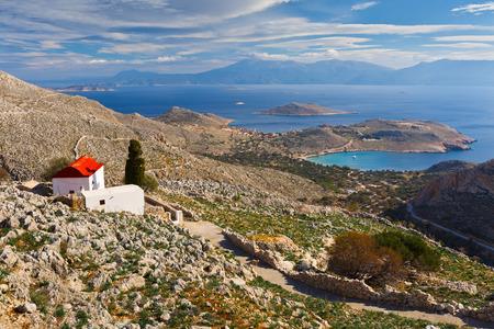 halki: Church on a hilside on Halki island in Dodecanese archipelago, Greece.