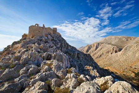 halki: Old castle on Halki island in Dodecanese archipelago, Greece.