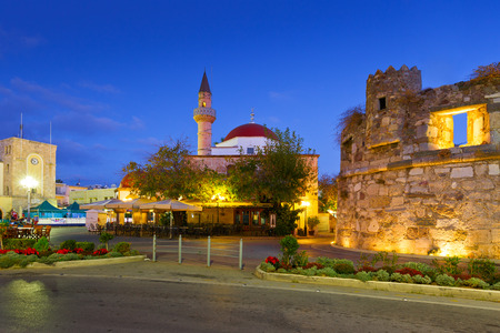 kos: Mosque and coffee shops in the main square of the Kos town. Editorial