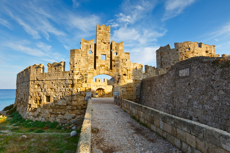 City gate and city walls of the medieval town of Rhodes. Stock Photo