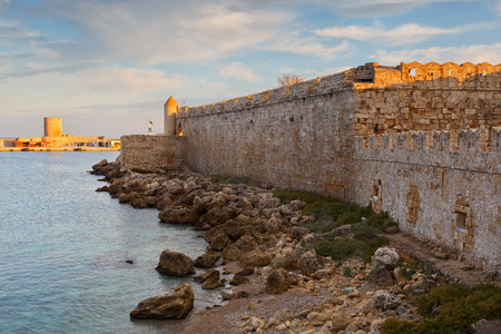 City walls and fortification of medieval harbor in town of Rhodes. Stock Photo