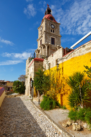 Medieval Roloi clock tower in the historic town of Rhodes. Stock Photo