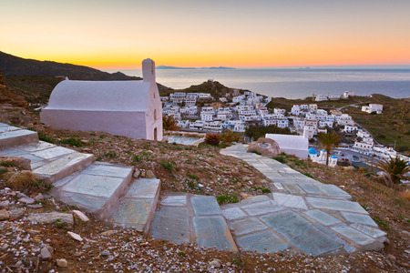 cycladic: View of Chora on Ios island early in the morning. Santorini island can be seen on the horizon.