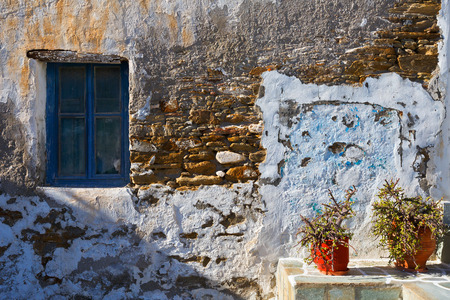 cycladic: Window on an old house in the main village of Ios island. Stock Photo