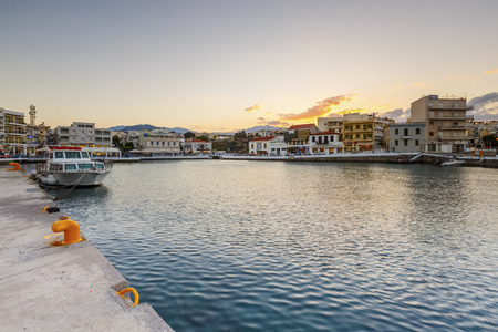 seafronts: Evening view of Agios Nikolaos and its harbor, Crete, Greece. Editorial
