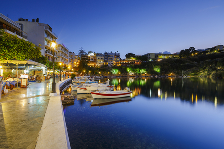 Evening view of Agios Nikolaos and its harbor, Crete, Greece. Editorial