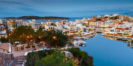 Agios Nikolaos, Greece - April 18, 2017: Evening view of Agios Nikolaos and its harbor, Crete, Greece.