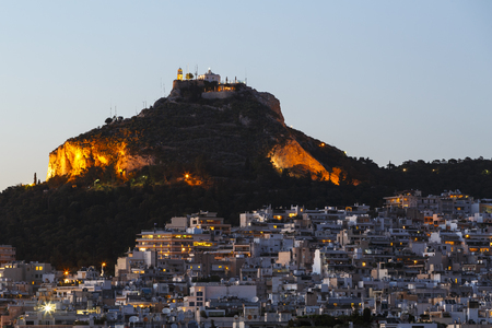 View of Lycabettus hill and one of the Athenian neighbourhoods, Greece.