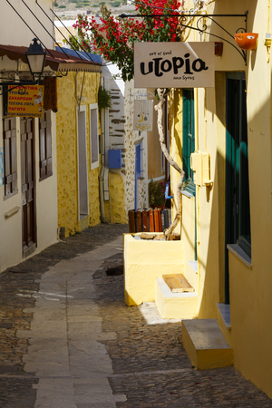 Street with shops in Ano Syros village on Syros island.